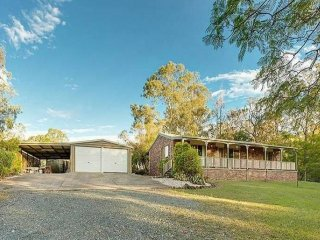 View profile: Horse Friendly 8 Acres with 4 Bay Shed and Solid Brick Home
